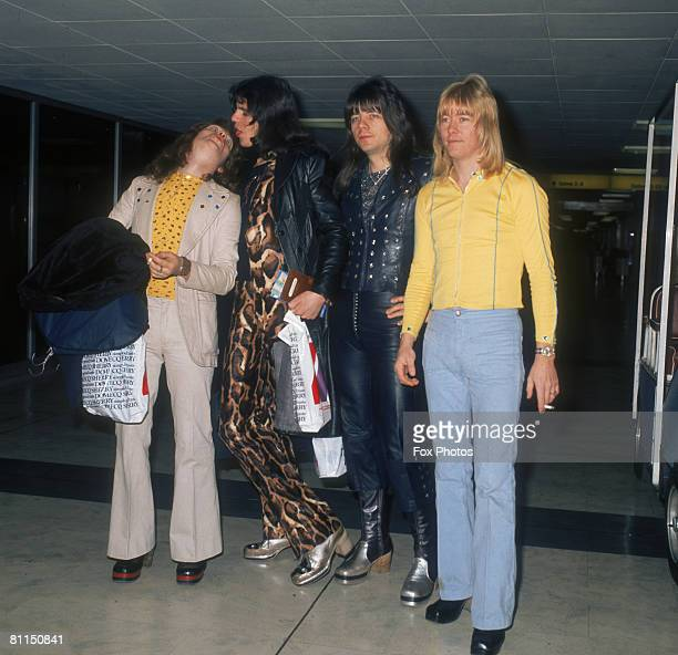 British glam rock group The Sweet Steve Priest Mick Tucker Andy Scott and Brian Connolly at Heathrow Airport November 1973