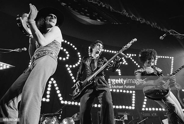 British glam rock group T-Rex performing at The Apollo, Glasgow, 22nd January 1974. Left to right: Mickey Finn , Steve Currie and Marc Bolan .