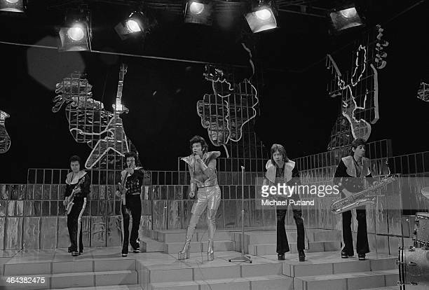 British glam rock singer Gary Glitter performing with the Glitter Band on the Christmas Day edition of the BBC TV music show 'Top Of The Pops'...