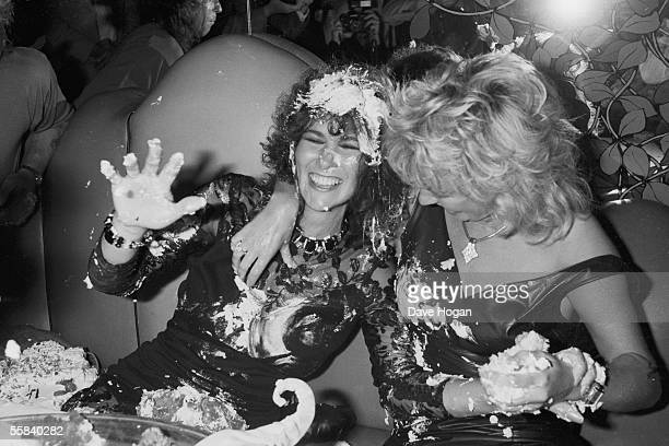 British glamour model Linda Lusardi is treated to a cake fight at her birthday party circa 1985