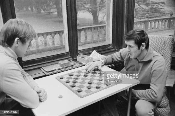 British goalkeeper Bill Glazier and soccer player Tony Hateley of Coventry City FC play draughts UK 14th December 1968