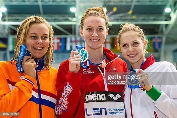 British gold medalist Jazmin Carlin Hungary's silver medalist Boglarka Kapas and Holland's bronze medalist Sharon Rouwendaal pose on the podium after...