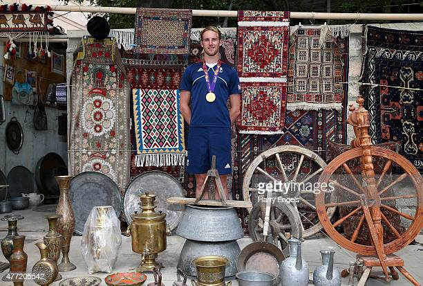 British Gold Medallist Gordon Benson poses for a photograph in the Baku Old Town the day after winning the Men's Triathlon on June 15 2015 in Baku...