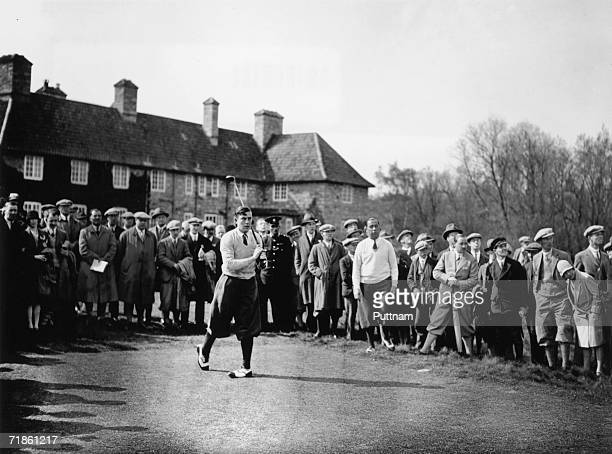 British golfer Henry Cotton is watched by America's Walter Hagen as he takes his turn at the 10th during the British Open Golf Championship at...