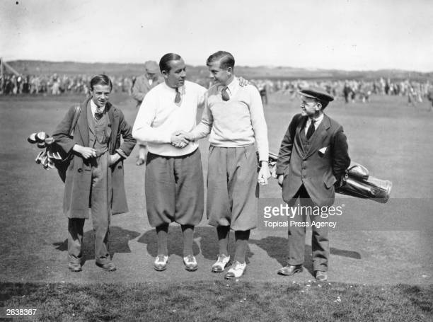 British golfer Henry Cotton right congratulating American player Walter Hagen on breaking the record at the last hole at the British Open Golf...
