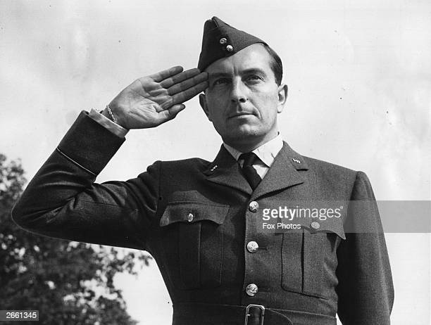 British golfer Henry Cotton saluting in his RAF pilot officer uniform