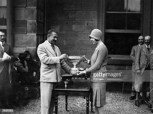 British golfer Joyce Wethered receiving her trophy from the captain elect of St Andrews golf club Lt Col Moncreiff Skene after beating American...