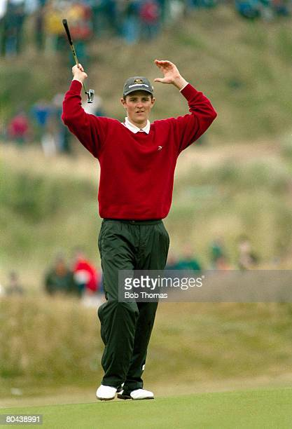 British golfer Justin Rose celebrates after chipping in from the 18th fairway to finish his final round during the British Open Golf Championship...