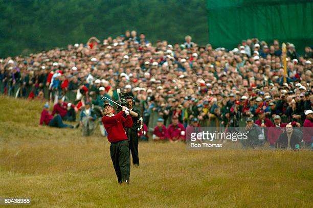 British golfer Justin Rose chipping in from the 18th fairway to finish his final round during the British Open Golf Championship held at Royal...