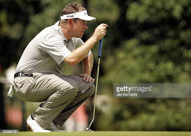 British golfer Lee Westwood lines up his putt on the 14th green during the second day of practice for the 2005 US Open Champshionship at Pinehurst...