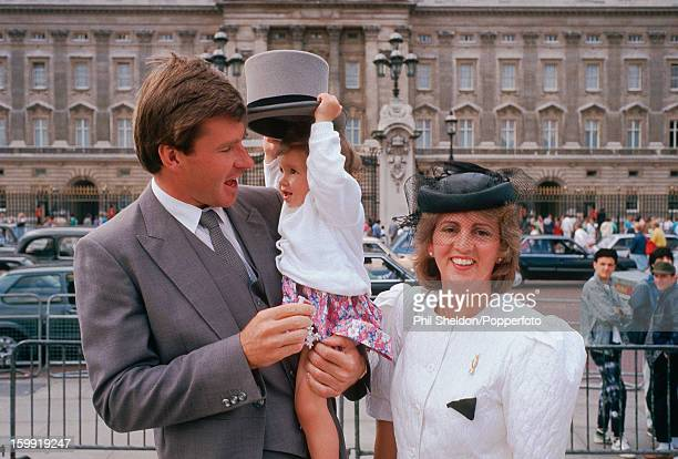 British golfer Nick Faldo with his wife Gill and daughter Natalie after receiving his MBE at Buckingham Palace London circa 1988