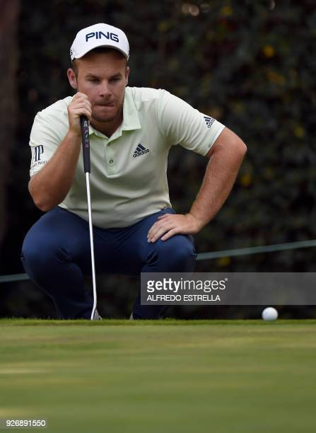 British golfer Tyrell Hatton eyes the ball at green sixteen during the third round of the World Golf Championship in Mexico City on March 3 2018 /...