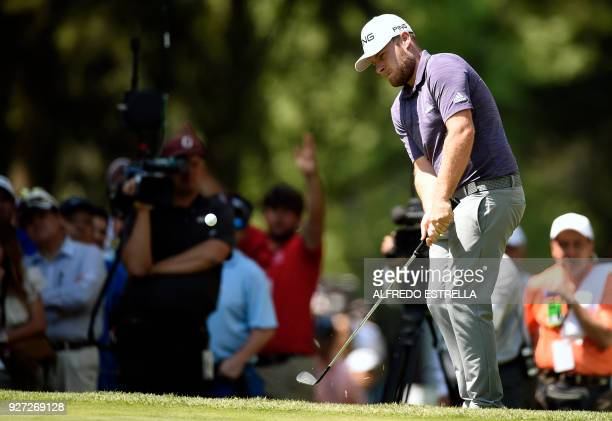 British golfer Tyrell Hatton plays his shot at green seven during the fourth and last round of the World Golf Championship in Mexico City on March 4...