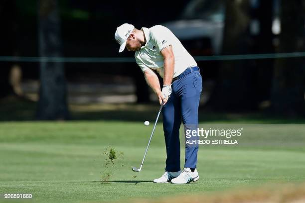 British golfer Tyrell Hatton plays his shot at green sixteen during the third round of the World Golf Championship in Mexico City on March 3 2018 /...