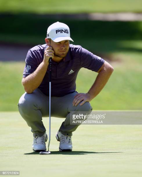 British golfer Tyrell Hatton studies his shot on green one during the fourth and last round of the World Golf Championship in Mexico City on March 4...