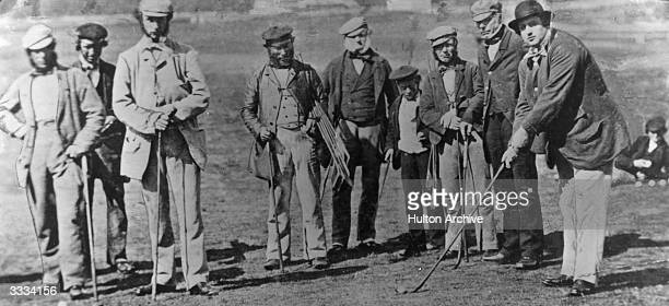 British golfers Captain Hay Wemyss 'Old' Tom Morris and Allan Robertson with his clubs under his arm at St Andrews in Scotland 'Old' Tom Morris and...