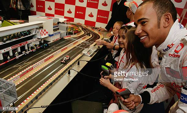 British Grand Prix driver Lewis Hamilton plays Scalextric with children from Great Ormond Street Hospital on the 2008 Abbey and Santander mini...