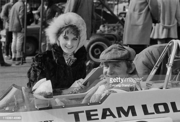 British Grand Prix motorcycle road racer Mike Hailwood with his girlfriend, fashion model Pauline Field, at the Guards European Formula 5000...