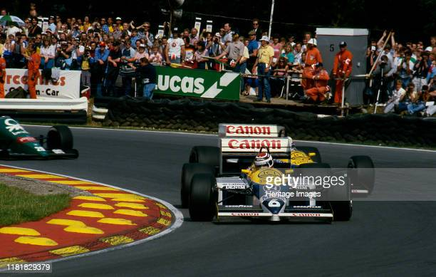 British Grand Prix Nelson Piquet leads Nigel Mansell in Williams FW11 at Brands Hatch. Creator: Unknown.