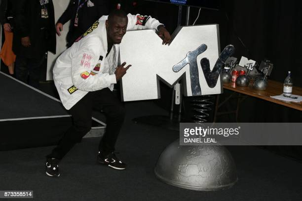 British grime and hip hop artist Stormzy poses in the winners' area during the 2017 MTV Europe Music Awards at Wembley Arena in London on November 12...