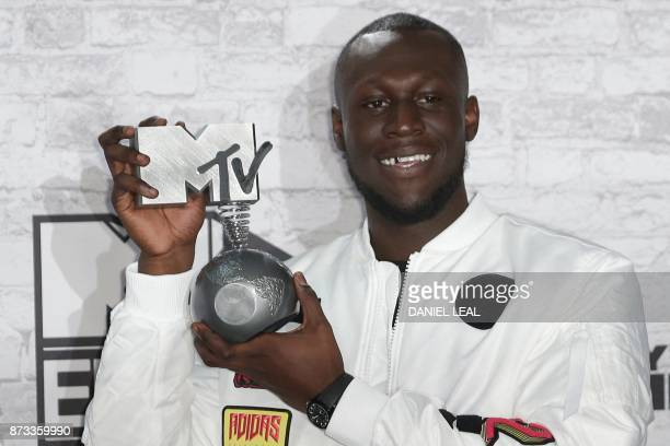 British grime and hip hop artist Stormzy poses in the winners' area with his worldwide act award during the 2017 MTV Europe Music Awards at Wembley...