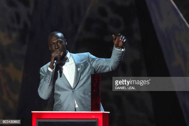 British grime and hiphop artist Stormzy collects the award for British male solo artist during the BRIT Awards 2018 ceremony and live show in London...