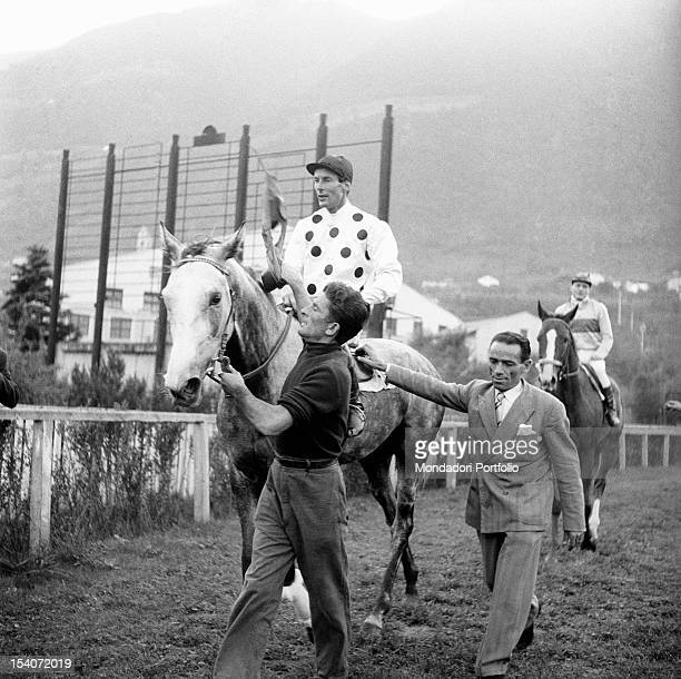 British group captain and aviator Peter Townsend riding a horse during a horse show. Merano, 1955