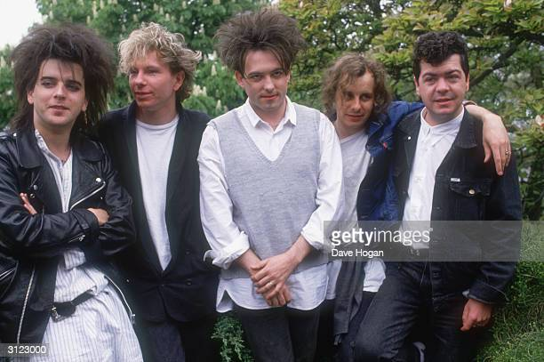 British group The Cure in 1987 the year they released the double album 'Kiss Me Kiss Me Kiss Me' From left to right they are bass player Simon Gallup...
