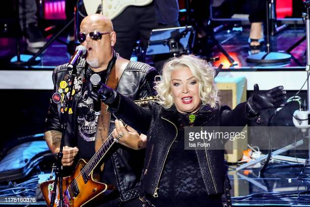 British guitarist and producer Ricky Wilde and his sister British singer Kim Wildeperform at Gottschalks Grosse 80er Show on September 6 2019 in...