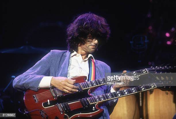 British guitarist and songwriter Jimmy Page in concert with Led Zeppelin 1983