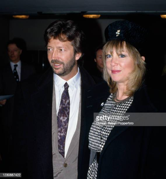 British guitarist Eric Clapton with his wife Pattie Boyd attending the Ivor Novello Awards at the Grosvenor House Hotel in London, England on April...
