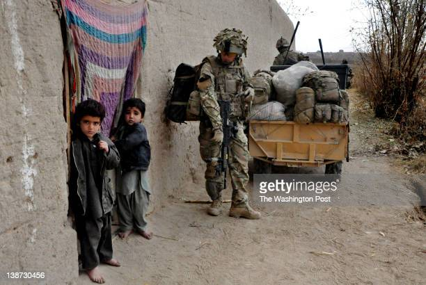 British Gurkha soldiers provides cover for a resupply tractor during a patrol in the village of Khar Nikah in Nahre Saraj district Helmand province...