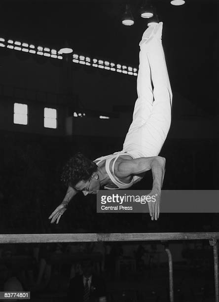 British gymnast Ken Buffin executes a flying backroll on the parallel bars at the Empress Hall Earl's Court during the London Summer Olympics 12th...