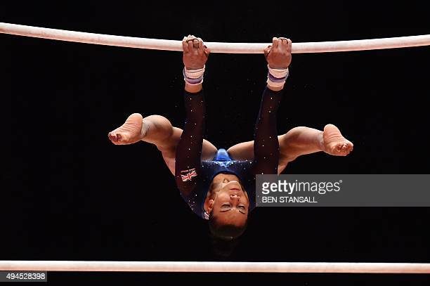 British gymnast Rebecca Downie competes on the uneven bars during the Women's Team event final on the fifth day of the 2015 World Gymnastics...