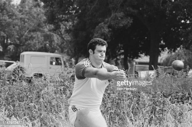 British hammer thrower Martin Girvan practicing outdoors, UK, 13th July 1984.