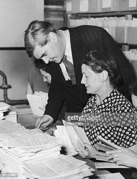 British Health Minister Aneurin Bevan inspects health cards during a visit to Insurance House in Holborn to check the progress of the new NHS 9th...