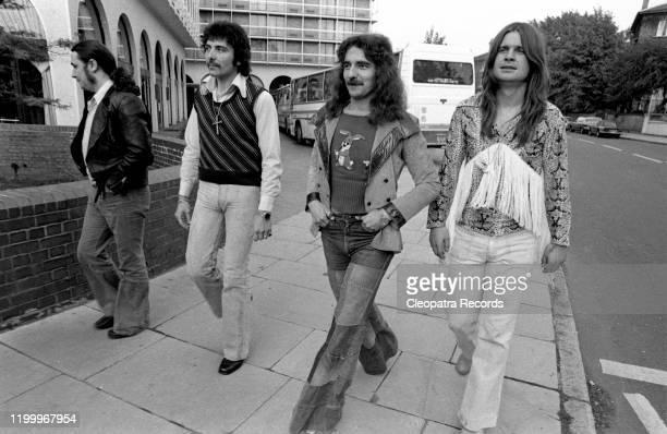 British heavy metal band Black Sabbath L-R Bill Ward, Tony Iommi, Geezer Butler, and Ozzy Osbourne pose for a portrait in 1975 in London, UK.