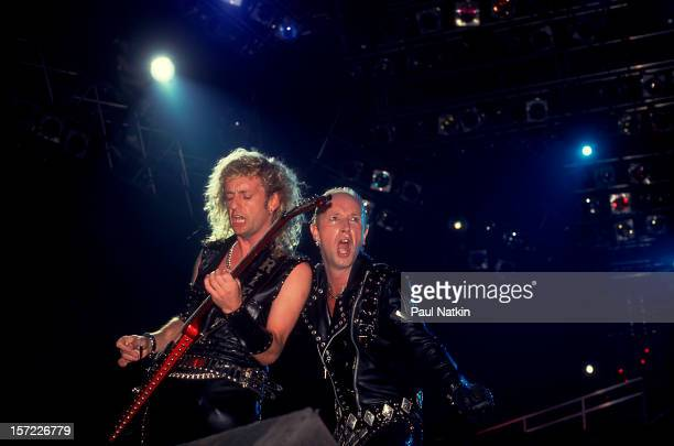 British heavy metal group Judas Priest perform onstage, 1986. Pictured are guitarist KK Downing and singer Rob Halford.