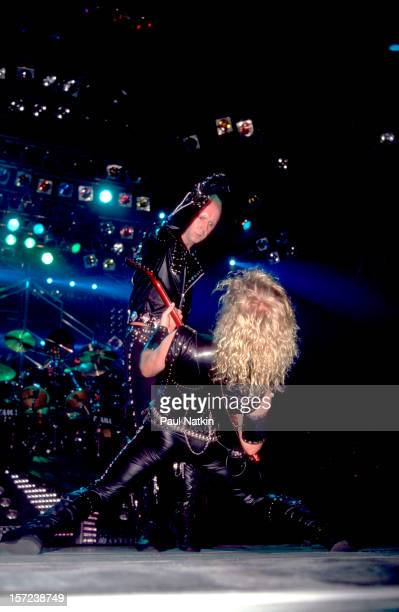 British heavy metal group Judas Priest perform onstage, 1986. Pictured are singer Rob Halford and guitarist KK Downing.