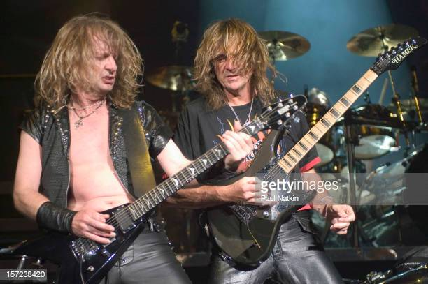 British heavy metal group Judas Priest perform onstage at Alpine Valley, East Troy, Wisconsin, August 14, 2004. Pictured are guitarists KK Downing...