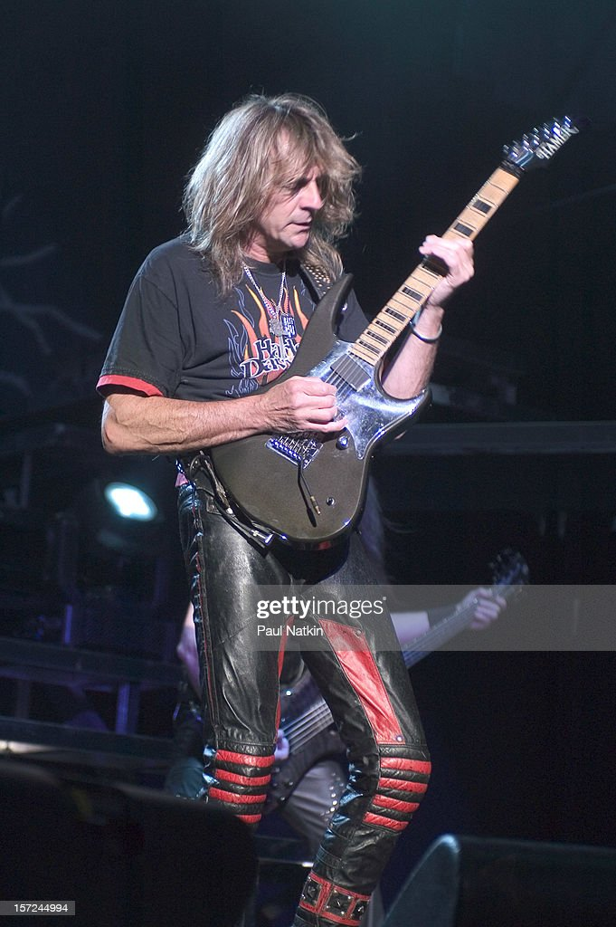 British heavy metal group Judas Priest perform onstage at Alpine Valley, East Troy, Wisconsin, August 14, 2004. Pictured is guitarist Glenn Tipton; bass player Ian Hill is visible in the background.