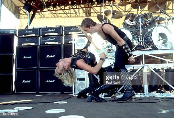 British heavy metal group Judas Priest perform onstage at the Rockford Speedway Loves Park Illinois July 27 1980 Pictured are guitarist KK Downing...