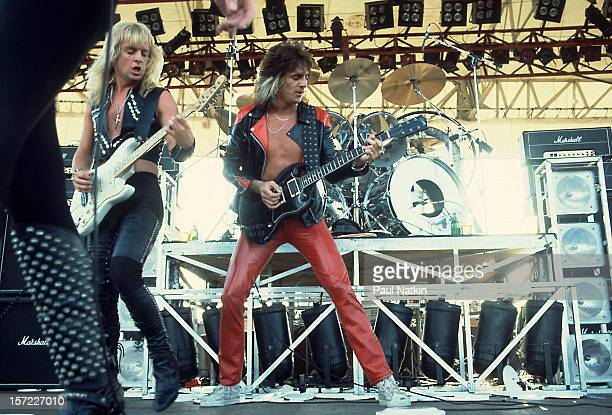 British heavy metal group Judas Priest perform onstage at the Rockford Speedway Loves Park Illinois July 27 1980 Pictured are guitarists KK Downing...