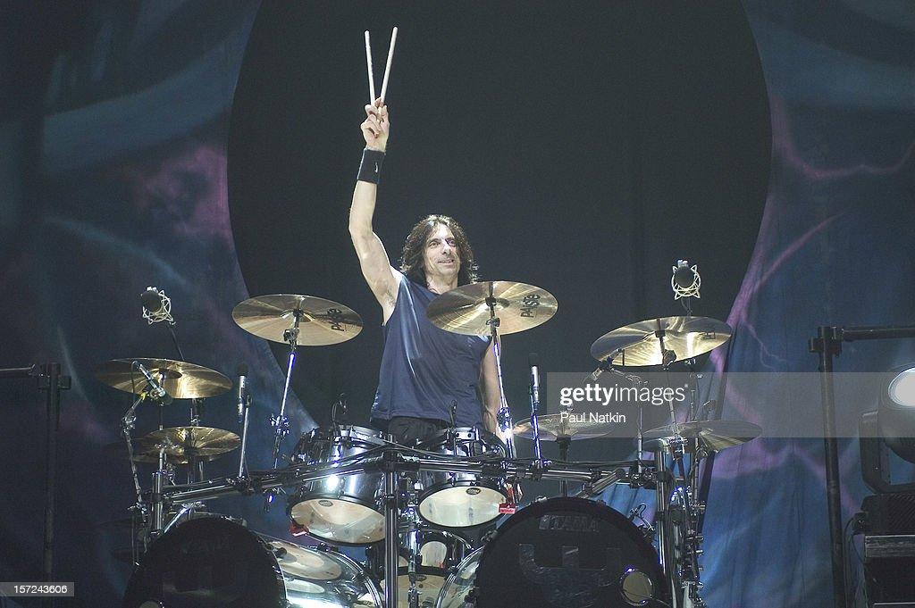 British heavy metal group Judas Priest perform onstage at the Tweeter Center, Chicago, Illinois, August 21, 2004. Pictured is drummer Scott Travis.