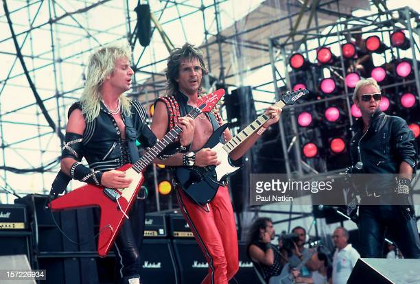 British heavy metal group Judas Priest perform onstage during Live Aid at Veteran's Stadium Philadelphia Pennsylvania July 13 1985 Pictured are from...