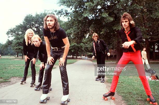British heavy metal group Judas Priest wearing roller skates on a visit to Central Park, New York, August 1979. L-R KK Downing;Rob Halford;Ian...
