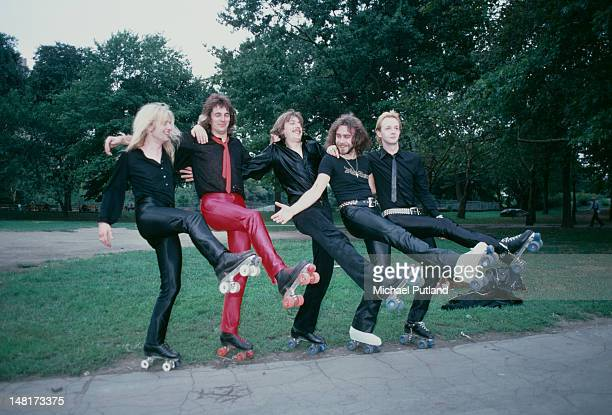 British heavy metal group Judas Priest wearing roller skates on a visit to Central Park, New York, August 1979. Left to right: KK Downing, Glenn...