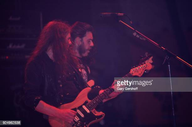 British Heavy Metal musicians Fast Eddie Clarke on guitar and Lemmy on bass both of the group Motorhead perform onstage at the Palladium New York New...