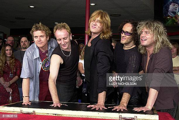 British heavy metal rock group 'Def Leppard' make their handprints to be put in the Rockwalk on the sidewalk in Hollywood 05 September 2000 From left...