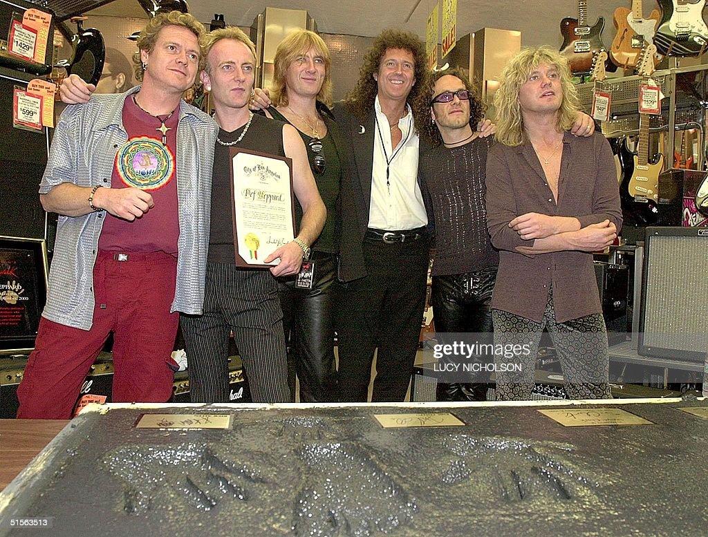 British heavy metal rock group 'Def Leppard' pose : News Photo